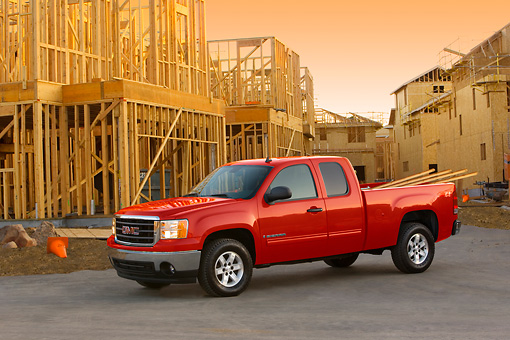 AUT 14 RK1325 01 © Kimball Stock 2007 GMC Sierra 1500 4WD Extended Cab SLE1 Red 3/4 Side View By Construction Site