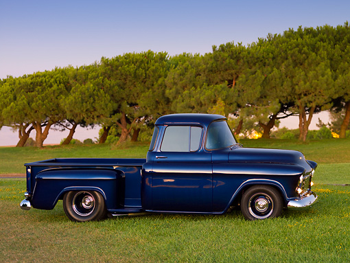 AUT 14 RK1351 01 © Kimball Stock 1956 Chevrolet 3100 Pick Up Truck Blue 3/4 Side View On Grass