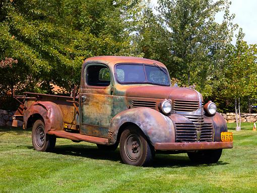 AUT 14 RK1352 01 © Kimball Stock 1940 Dodge Pickup Truck Rusty Front 3/4 View On Grass By Trees