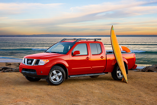 AUT 14 RK1387 01 © Kimball Stock 2008 Nissan Frontier Crew Cab LE Pickup Truck Red 3/4 Front View At Beach