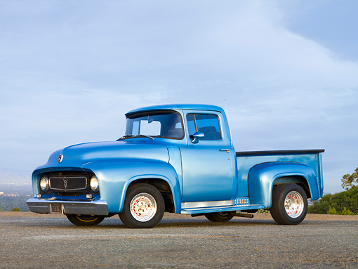 AUT 14 RK1398 01 © Kimball Stock 1956 Ford F-100 Pickup Truck Blue 3/4 Front View On Pavement