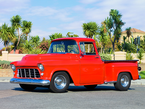 AUT 14 RK1402 01 © Kimball Stock 1957 Chevrolet Stepside Pickup Truck Red 3/4 Front View On Pavement By Palm Trees
