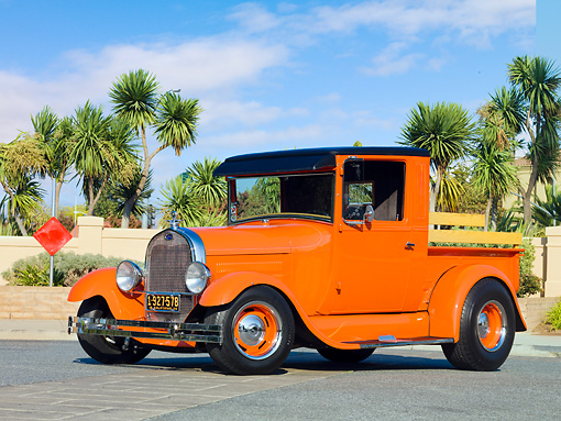 AUT 14 RK1404 01 © Kimball Stock 1928 Ford Model A Pickup Truck Orange 3/4 Front View On Pavement By Palm Trees