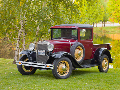 AUT 14 RK1408 01 © Kimball Stock 1930 Ford Model A Pickup Truck Maroon 3/4 Front View On Grass By Trees