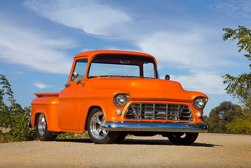 AUT 14 RK1409 01 © Kimball Stock 1956 Chevrolet Pickup Truck Orange 3/4 Front View On Pavement Blue Sky