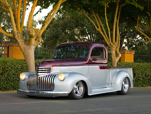 AUT 14 RK1415 01 © Kimball Stock 1946 Chevrolet Pickup Truck Silver And Maroon 3/4 Front View On Pavement By Trees