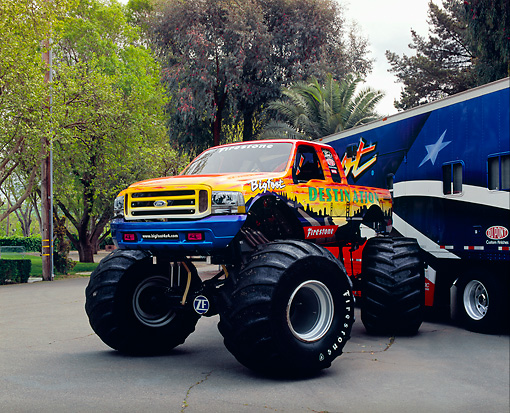 AUT 14 RK1416 01 © Kimball Stock 2003 Ford Bigfoot Destination Monster Truck 3/4 Front View On Pavement