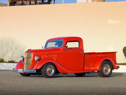 AUT 14 RK1420 01 © Kimball Stock 1935 Ford Pickup Truck Red 3/4 Front View On Pavement By Fence