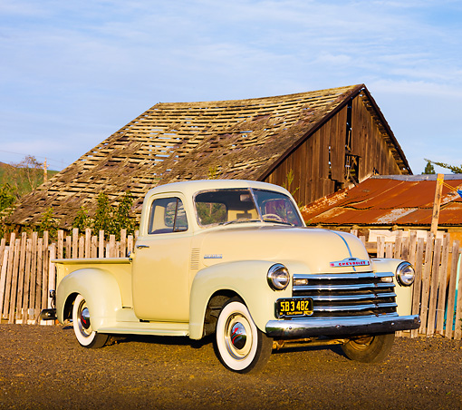 AUT 14 RK1475 01 © Kimball Stock 1952 Chevrolet 3100 Pickup Truck Tan And Green 3/4 Front View On Dirt By Fence And Barn