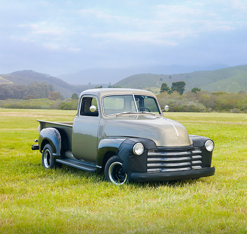 AUT 14 RK1486 01 © Kimball Stock 1949 Chevrolet 1/2 Ton Pickup Truck Tan 3/4 Front View On Grass By Hills