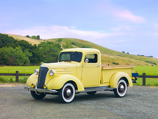 AUT 14 RK1494 01 © Kimball Stock 1937 Chevrolet GC Pickup Truck Yellow 3/4 Front View On Road By Hills