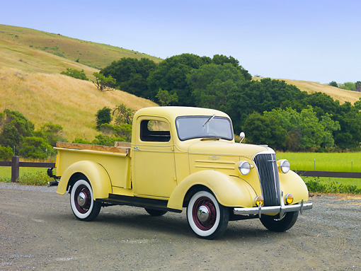 AUT 14 RK1495 01 © Kimball Stock 1937 Chevrolet GC Pickup Truck Yellow 3/4 Front View On Road By Hills