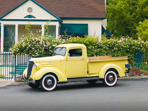AUT 14 RK1498 01 © Kimball Stock 1937 Chevrolet GC Pickup Truck Yellow 3/4 Front View On Pavement By House