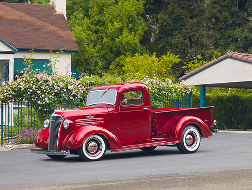 AUT 14 RK1499 01 © Kimball Stock 1937 Chevrolet Pickup Truck Red 3/4 Front View On Pavement By House