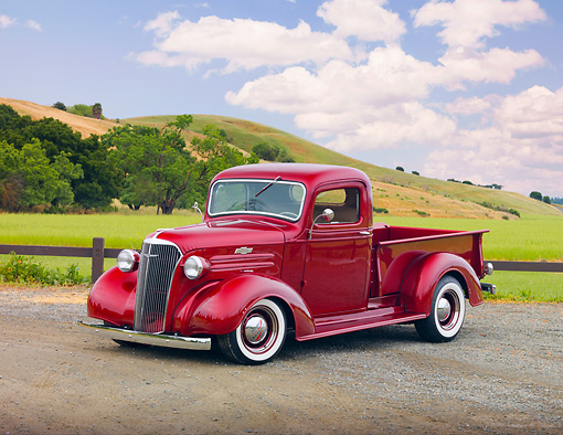 AUT 14 RK1502 01 © Kimball Stock 1937 Chevrolet Pickup Truck Red 3/4 Front View On Road By Hills