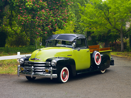 AUT 14 RK1505 01 © Kimball Stock 1950 Chevrolet 3100 Pickup Truck Green And Black 3/4 Front View On Pavement By Trees