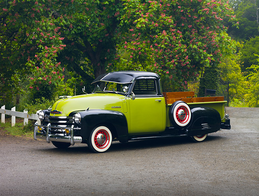 AUT 14 RK1506 01 © Kimball Stock 1950 Chevrolet 3100 Pickup Truck Green And Black 3/4 Front View On Pavement By Trees