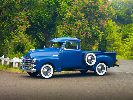 AUT 14 RK1509 01 © Kimball Stock 1950 Chevrolet 3100 Pickup Truck Blue 3/4 Front View On Pavement By Trees