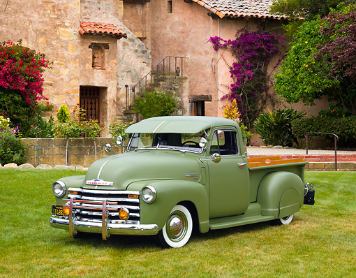 AUT 14 RK1511 01 © Kimball Stock 1950 Chevrolet 3100 Pickup Truck Green 3/4 Front View On Grass By Trees