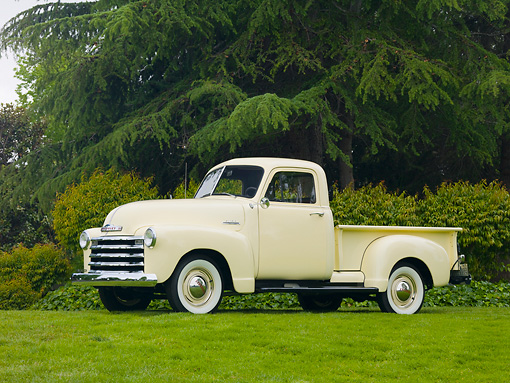 AUT 14 RK1513 01 © Kimball Stock 1953 Chevrolet Pickup Truck Flax 3/4 Front View On Grass By Trees
