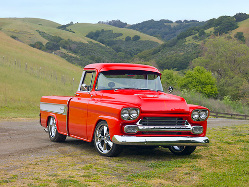 AUT 14 RK1515 01 © Kimball Stock 1958 Chevrolet Cameo Pickup Truck Red 3/4 Front View On Grass By Hills