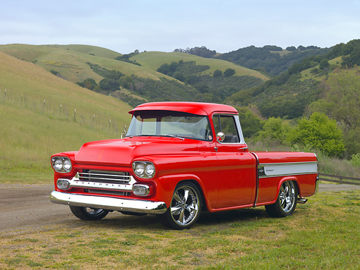 AUT 14 RK1516 01 © Kimball Stock 1958 Chevrolet Cameo Pickup Truck Red 3/4 Front View On Grass By Hills
