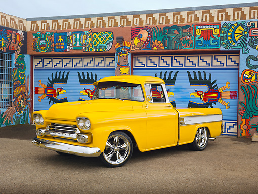 AUT 14 RK1517 01 © Kimball Stock 1958 Chevrolet Cameo Pickup Truck Yellow 3/4 Front View On Pavement By Colorful Building