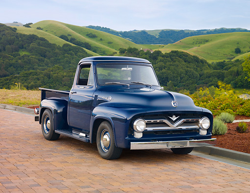 AUT 14 RK1523 01 © Kimball Stock 1955 Ford F-100 Dark Blue 3/4 Front View On Bricks By Hills