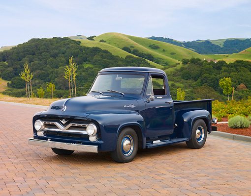 AUT 14 RK1524 01 © Kimball Stock 1955 Ford F-100 Dark Blue 3/4 Front View On Bricks By Hills