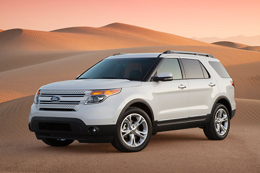 AUT 15 BK0005 01 © Kimball Stock 2012 Ford Explorer White 3/4 Front View On Sand Dunes At Dusk