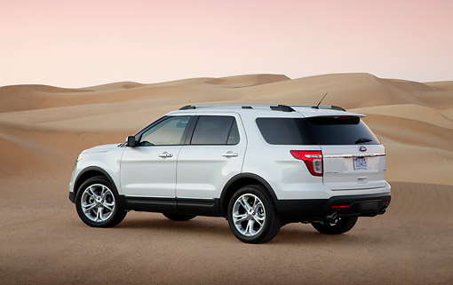 AUT 15 BK0006 01 © Kimball Stock 2012 Ford Explorer White 3/4 Rear View On Sand Dunes At Dusk