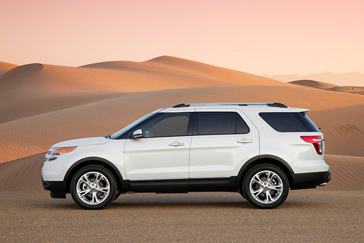 AUT 15 BK0007 01 © Kimball Stock 2012 Ford Explorer White Profile View On Sand Dunes At Dusk