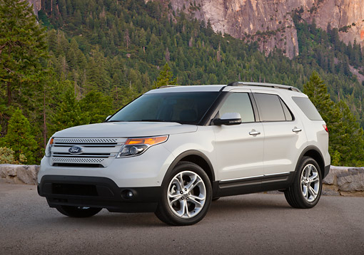 AUT 15 BK0008 01 © Kimball Stock 2012 Ford Explorer White 3/4 Front View On Pavement By Mountains