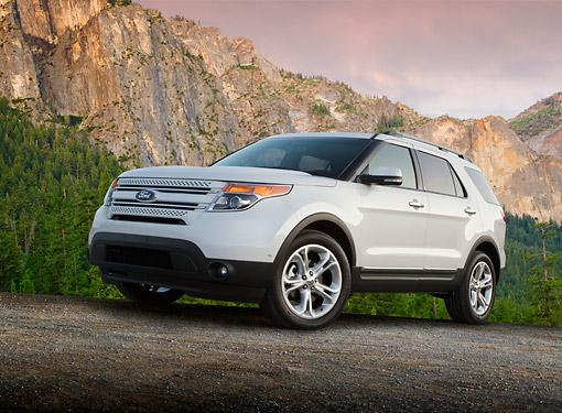 AUT 15 BK0009 01 © Kimball Stock 2012 Ford Explorer White 3/4 Front View On Gravel By Mountains
