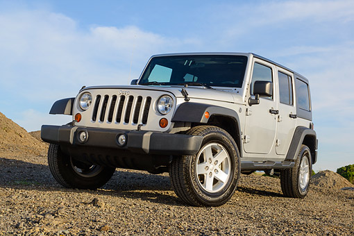 AUT 15 BK0037 01 © Kimball Stock 2013 Jeep Wrangler Sport Unlimited Silver 3/4 Front View On Dirt