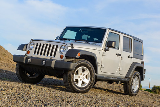 AUT 15 BK0038 01 © Kimball Stock 2013 Jeep Wrangler Sport Unlimited Silver 3/4 Front View On Dirt