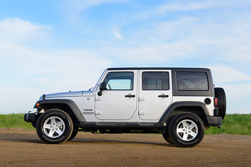 AUT 15 BK0039 01 © Kimball Stock 2013 Jeep Wrangler Sport Unlimited Silver Profile View On Dirt