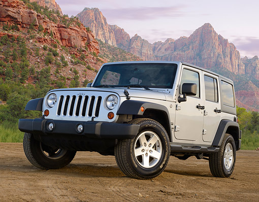 AUT 15 BK0040 01 © Kimball Stock 2013 Jeep Wrangler Sport Unlimited Silver 3/4 Front View On Dirt By Red Rock