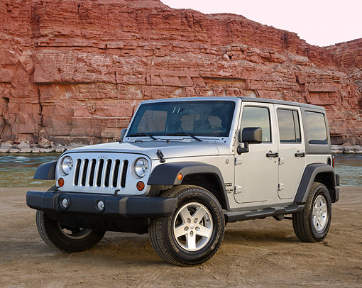 AUT 15 BK0041 01 © Kimball Stock 2013 Jeep Wrangler Sport Unlimited Silver 3/4 Front View On Dirt By Red Rock