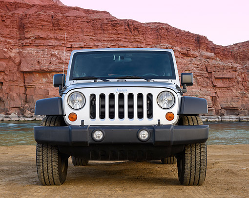 AUT 15 BK0042 01 © Kimball Stock 2013 Jeep Wrangler Sport Unlimited Silver Front View On Dirt By Red Rock
