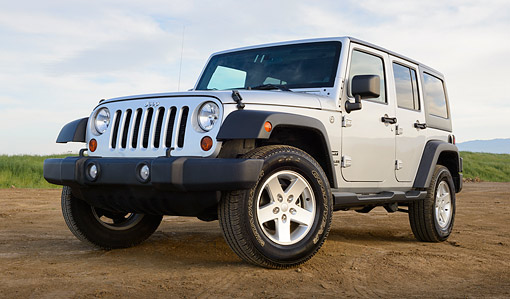 AUT 15 BK0043 01 © Kimball Stock 2013 Jeep Wrangler Sport Unlimited Silver 3/4 Front View On Dirt