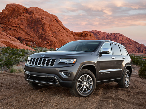 AUT 15 BK0047 01 © Kimball Stock 2014 Jeep Grand Cherokee Limited 4X4 Gray 3/4 Front View On Dirt In Desert