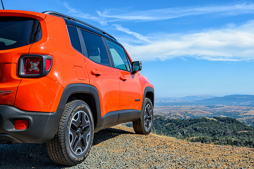 AUT 15 BK0063 01 © Kimball Stock 2015 Jeep Renegade Trailhawk Orange 3/4 Rear View On Mountains