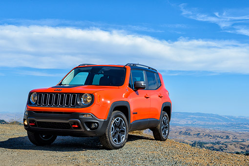 AUT 15 BK0065 01 © Kimball Stock 2015 Jeep Renegade Trailhawk Orange 3/4 Front View On Mountains