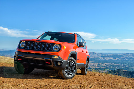 AUT 15 BK0068 01 © Kimball Stock 2015 Jeep Renegade Trailhawk Orange 3/4 Front View On Mountains