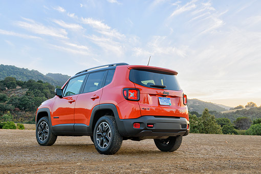 AUT 15 BK0069 01 © Kimball Stock 2015 Jeep Renegade Trailhawk Orange 3/4 Rear View On Mountains