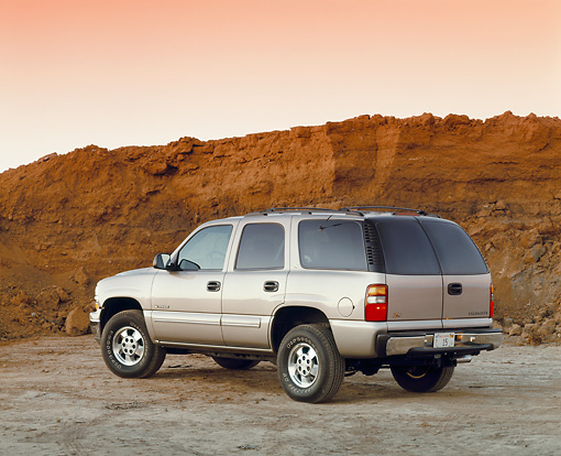 AUT 15 RK0421 02 © Kimball Stock 2000 Chevrolet Tahoe 4WD Pewter 3/4 Rear View On Dirt Filtered