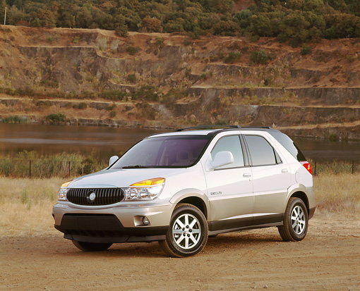 AUT 15 RK0543 03 © Kimball Stock 2002 Buick Rendezvous AWD White 3/4 Front View On Dirt By Quarry