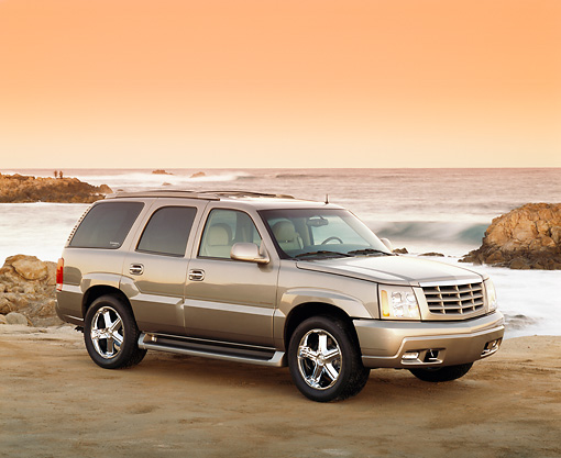 AUT 15 RK0596 07 © Kimball Stock 2002 Cadillac Escalade Canepa Design LE Pewter 3/4 Front View On Beach Filtered