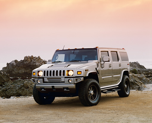 AUT 15 RK0731 03 © Kimball Stock 2003 H2 Hummer Canepa Custom Matte Pewter Low 3/4 Front View On Sand By Rocks Filtered